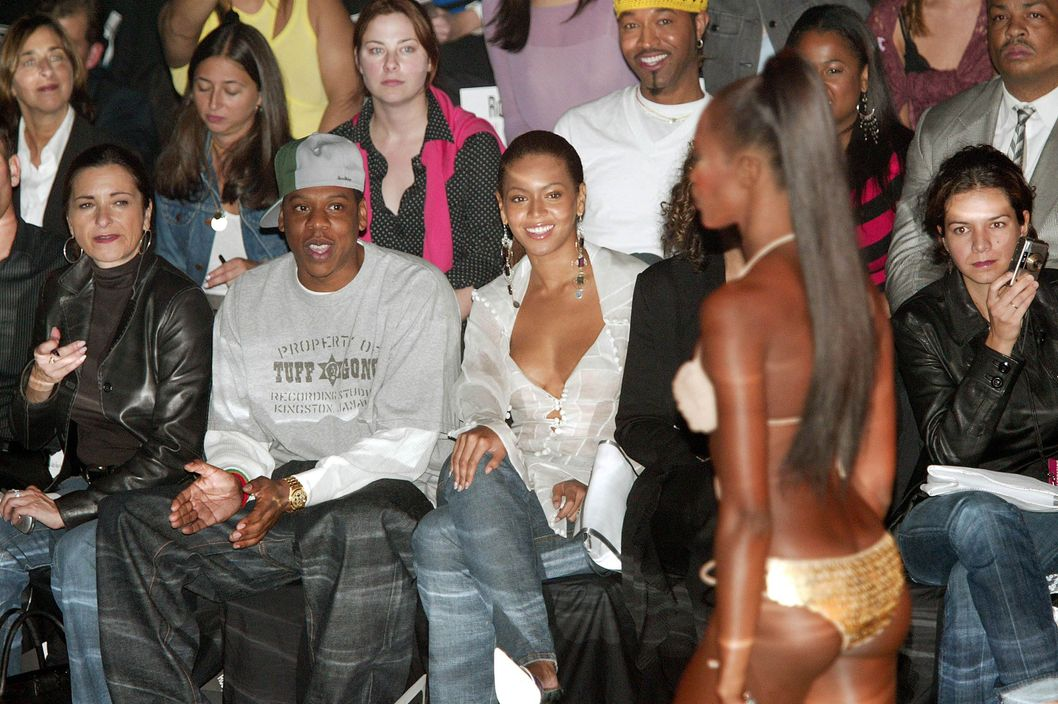 NEW YORK - SEPTEMBER 12:  Rapper Jay Z and singer Beyonce Knowles watch model Naomi Campbell walk the runway at the Rosa Cha by Amir Slama Spring/Summer 2004 Collection at Bryant Park during the 7th on Sixth Mercedes-Benz Fashion Week on September 13, 2003 in New York City.  (Photo by Evan Agostini/Getty Images)