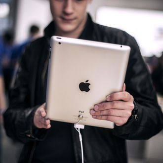 Customers test new IPad, on April 4, 2012 at the newly Apple store inside the Confluence shopping centre in Lyon, on the day of its inauguration. AFP PHOTO / JEFF PACHOUD (Photo credit should read JEFF PACHOUD/AFP/Getty Images)