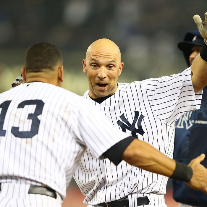 Raul Ibanez #27 of the New York Yankees celebrates with Alex Rodriguez #13 after hitting a walk-off single against the Boston Red Sox in the twelfth inning to win the game 4-3 on October 2, 2012 at Yankee Stadium.
