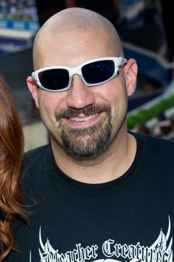 NEW YORK, NY - MAY 24:  Actress Joanna Garcia-Swisher (L) and Bald Vinny Milano participate in roll call with the Bleacher Creatures at the Toronto Blue Jays vs the New York Yankees game at Yankee Stadium on May 24, 2011 in New York City.  (Photo by Michael Stewart/WireImage)