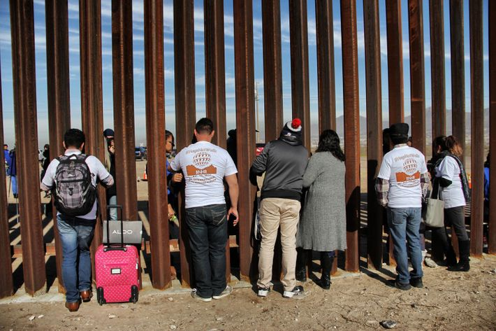 Relatives meeting at the border wall between Mexico and the U.S. in 2017.