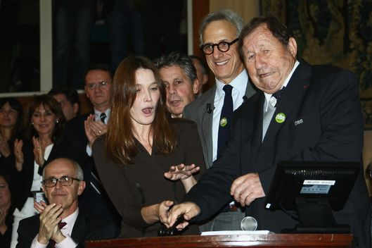 Carla Bruni-Sarkozy and Guy Roux (R) animate the 152th Hospices de Beaune wine auction on November 18, 2012 in Beaune, France.