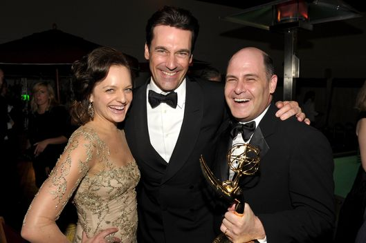BEVERLY HILLS, CA - SEPTEMBER 18:  (L-R) Actors Elisabeth Moss, Jon Hamm, and producer Matthew Weiner attend the AMC After Party for the 63rd Annual EMMY Awards held at Mr. C Beverly Hills on September 18, 2011 in Beverly Hills, California.  (Photo by John Shearer/Getty Images for AMC)