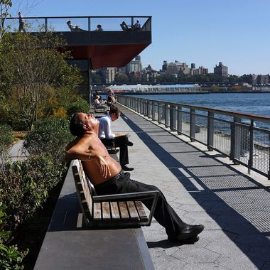 NEW YORK, NY - OCTOBER 02:  A man relaxes by the water during unseasonably warm temperatures on October 2, 2013 in New York City.  Despite the passing of summer and the arrival of autumn, New York and much of the East Coast has been experiencing warm and dry weather with temperatures reaching up into the 80's today.  (Photo by Spencer Platt/Getty Images)