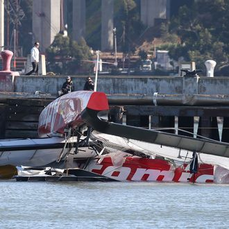 SAN FRANCISCO, CA - MAY 09: The bottom of the Artemis Racing AC-72 catamaran is seen in the water at Hangar 3 at Treasure Island on May 9, 2013 in San Francisco, California. British sailor Andrew Simpson, a member of the Swedish America's Cup racing team died when he was submerged underwater for 10 minutes after the team's racing boat capsized on the San Francisco Bay. (Photo by Justin Sullivan/Getty Images)