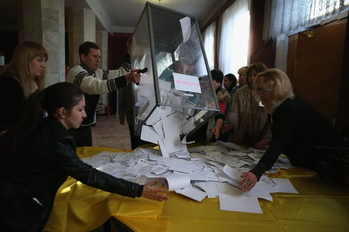 SLOVYANSK, UKRAINE - MAY 11: Election workers dump a ballot box to count votes following eastern Ukraine's sovereignty referendum on May 11, 2014 in Slovyansk, Ukraine. Pro-Russian communities in eastern Ukraine staged the vote in defiance of federal and international pressure. (Photo by John Moore/Getty Images)