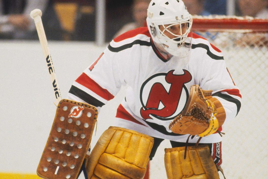 "EAST RUTHERFORD, NJ - 1983: The New Jersey Devils' goalie Glenn ""Chico"" Resch #1 guards the corner during a game at the Meadowlands Arena for the 1982-83 season in East Rutherford, New Jersey. (Photo by Focus on Sport/Getty Images)"