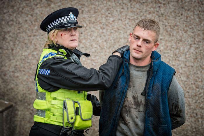 Catherine Cawood (Sarah Lancashire) making an arrest.