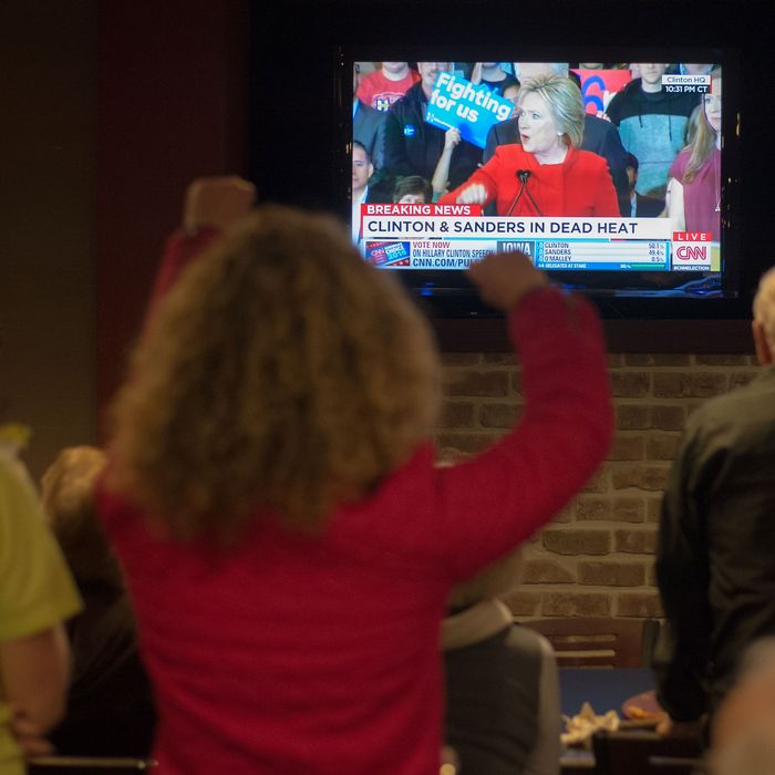 Clinton staffers watch Monday's speech in the Burlington, Iowa, office.