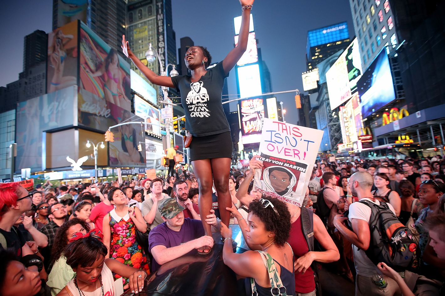 NEW YORK, NY - JULY 14:  Trayvon Martin supporters rally in Times Square while blocking traffic after marching from a rally for Martin in Union Square in Manhattan on July 14, 2013 in New York City. George Zimmerman was acquitted of all charges in the shooting death of Martin July 13 and many protesters questioned the verdict.  (Photo by Mario Tama/Getty Images)