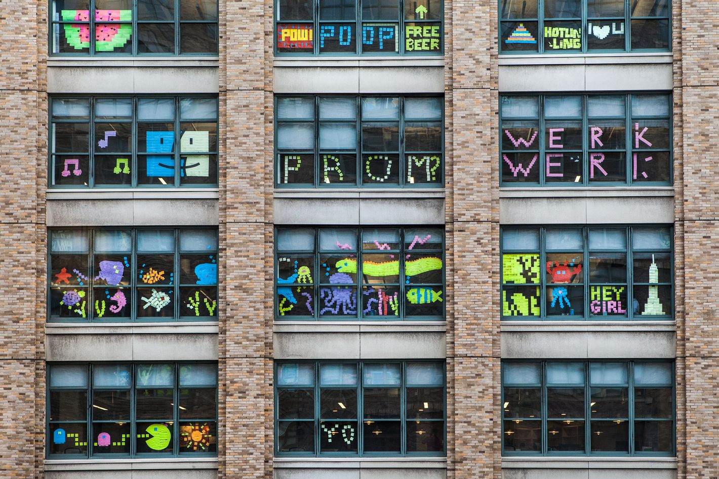 Two Buildings On Canal Street Are Waging A Post It War In Their Windows