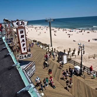 SEASIDE HEIGHTS, NJ - MAY 27: People walk on the boardwalk on the first weekend of Jersey Shore beaches re-opening to the public on May 27, 2013 in Seaside Heights, New Jersey. The region continues to recover and rebuild after Hurricane Sandy devastated parts of the coastline. (Photo by Kena Betancur/Getty Images)