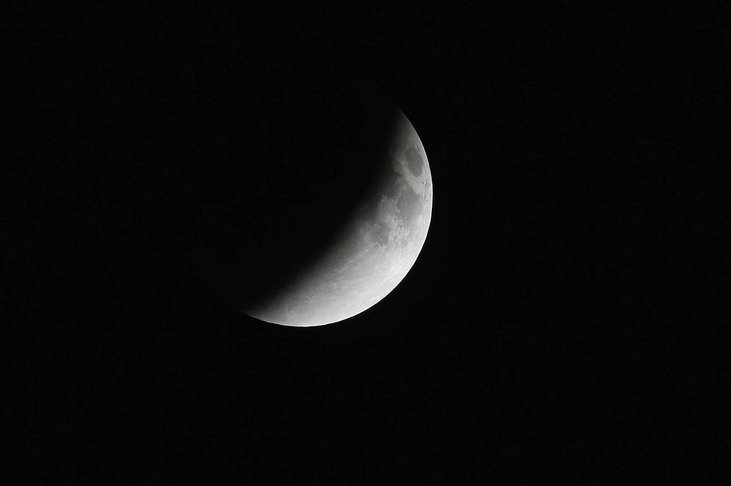 MIAMI, FL - APRIL 15:  The moon is seen as it  heads into a total lunar eclipse on April 15, 2014 in Miami, Florida. People in most of north and south America should be able to witness this year's first total lunar eclipse, which will cause a 'blood moon' and is the first of four in a rare Tetrad of eclipses over the next two years. (Photo by Joe Raedle/Getty Images)