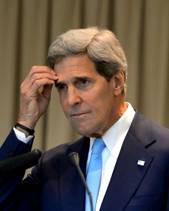US Secretary of State John Kerry gestures during a joint press conference with Pakistan's Adviser for National Security and Foreign Affairs Sartaj Aziz at the Prime Minister's House in Islamabad on August 1, 2013. Kerry said that he was confident Washington would reach an agreement with Kabul that would allow American troops to remain in Afghanistan beyond 2014.