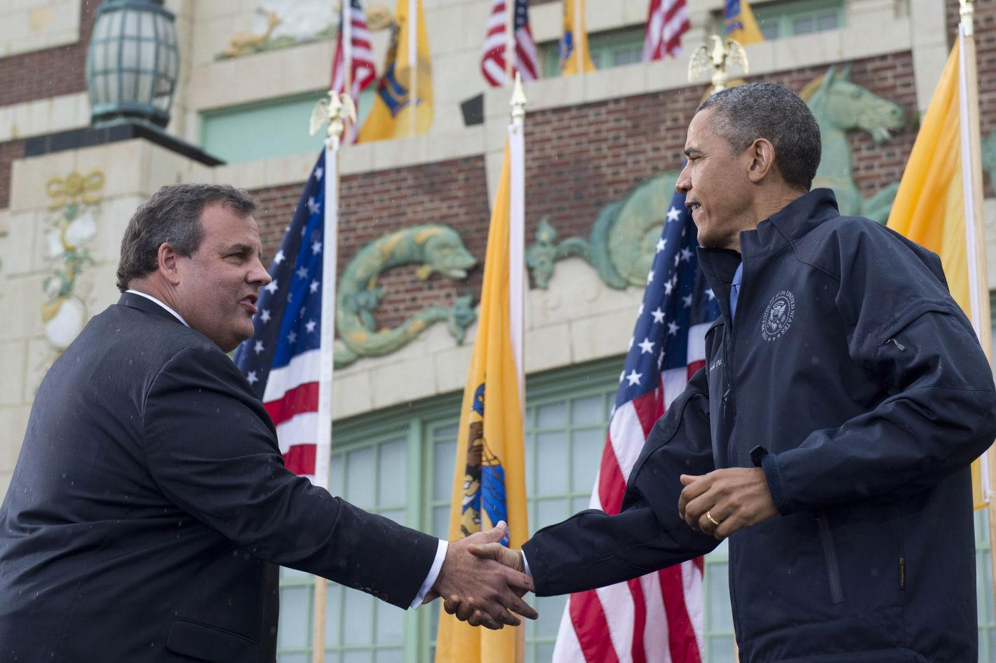 US President Barack Obama shakes hands with New Jersey Governor Chris Christie (L) before speaking about rebuilding efforts following last year's Hurricane Sandy at the Asbury Park Convention Hall in Asbury Park, New Jersey, on May 28, 2013