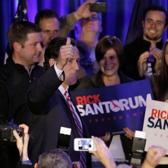 Republican presidential candidate, former Pennsylvania Sen. Rick Santorum gestures to supporters as he enters his victory party Tuesday, Jan. 3, 2012, in Johnston, Iowa. (AP Photo/Charlie Riedel)