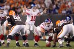 Quarterback Eli Manning #10 of the New York Giants calls the play at the line during the game against the Cleveland Browns on October 13, 2008 at Cleveland Browns Stadium in Cleveland, Ohio.