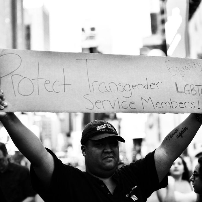 A protester in front of the US Army career center in Times Square on July 26, the day Trump announced that transgender people may not serve