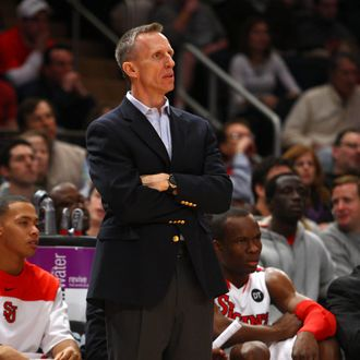 Acting head coach Mike Dunlap of the St. John's Red Storm looks on against the UCLA Bruins at Madison Square Garden on February 18, 2012 in New York City.