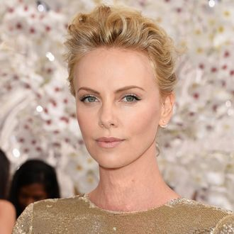 PARIS, FRANCE - JULY 07: Charlize Theron attends the Christian Dior show as part of Paris Fashion Week - Haute Couture Fall/Winter 2014-2015 on July 7, 2014 in Paris, France. (Photo by Pascal Le Segretain/Getty Images)