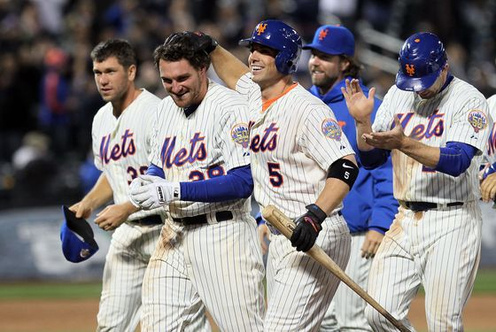 NEW YORK, NY - APRIL 09:  Daniel Murphy #28 of the New York Mets celebrates his walk off single against the Washington Nationals with teammate David Wright #5 at Citi Field on April 9, 2012 in the Flushing neighborhood of the Queens borough of New York City.  (Photo by Jim McIsaac/Getty Images)