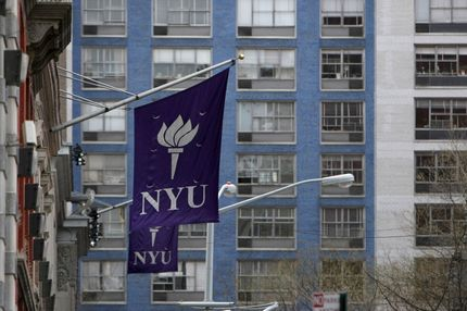 New York University banners hang from a building in New York, U.S.