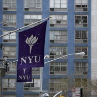 New York University banners hang from a building in New York, U.S., on Monday, April 5, 2010. New York University will face financial hurdles and a fight with Greenwich Village preservationists as it tries to take over more space and compete harder with uptown rival Columbia University. Photographer: Jin Lee/Bloomberg via Getty Images