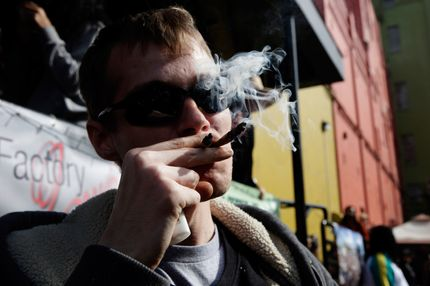Anthony Nitowski smokes two joints outside at Hempfest on April 20, 2014 in Seattle, Washington. Seattle Hempfest is an annual event for the purpose of educating the public about the benefits of marijuana and advocating for its decriminalization.