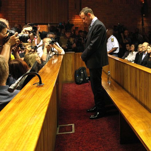 Olympic athlete Oscar Pistorius stands in the dock during his bail hearing at the magistrates court in Pretoria, South Africa, Friday, Feb. 22, 2013. The fourth and likely final day of Oscar Pistorius' bail hearing opened on Friday, with the magistrate then to rule if the double-amputee athlete can be freed before trial or if he has to remain in custody over the shooting death of his girlfriend.