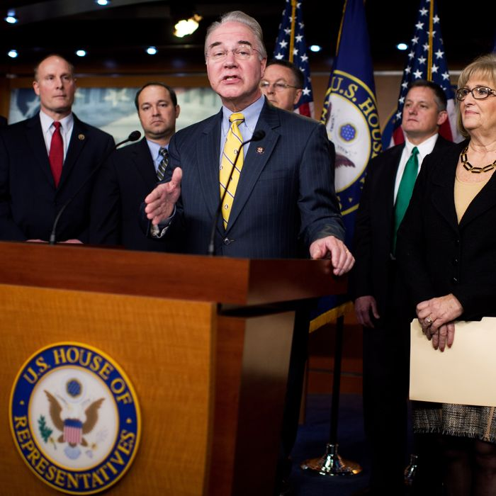 UNITED STATES - MARCH 17: Rep. Tom Price, R-Ga., chairman of the House Budget Committee, conducts a news conference in the Capitol Visitor Center to introduce the FY2016 budget resolution and discuss ways to balance the budget, March 17, 2015. Also appearing from left are Reps. Rob Woodall, R-Ga., John Moolenaar, R-Mich., Marlin Stutzman, R-Ind., Rod Blum, R-Iowa, Bruce Westerman, R-Ark., Diane Black, R-Tenn., Todd Rokita, R-Ind., and Dave Brat, R-Va., (Photo By Tom Williams/CQ Roll Call)