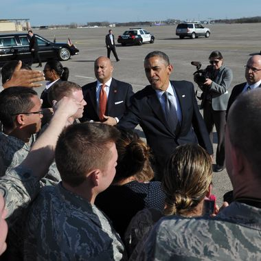 US President Barack Obama greets well-wishers upon his arrival at Bradley Air National Guard Base in Hartford, Connecticut on April 8, 2013. Obama is in Hartford to speak on gun control at the University of Hartford.  AFP PHOTO/Mandel NGAN        (Photo credit should read MANDEL NGAN/AFP/Getty Images)