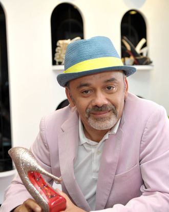 Christian Louboutin and his beloved red soles.
