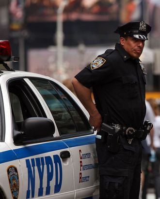 NEW YORK - APRIL 06: A New York City police officer stands on patrol on April 6, 2010 in New York City. Following a melee involving groups of youths around Times Square last Sunday evening, concern is growing that New York City may be witnessing a resurgence in crime. Crime is up while fewer officers are patrolling the streets due to budget cuts in the police department, with more officers assigned to terrorism related security details. Shootings in New York City are up 19 percent and murders up 22 percent over the same period last year. (Photo by Spencer Platt/Getty Images)