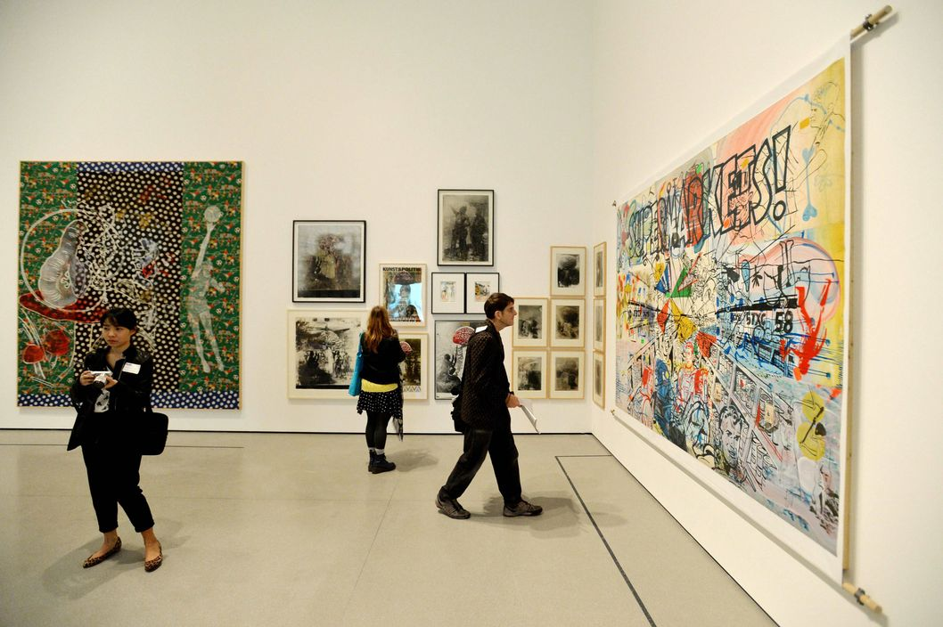 People look at artworks displayed at a major retrospective of German artist Sigmar Polke entitled 'Alibis: Sigmar Polke 1963–2010' during a preview of the show at the Museum of Modern Art in New York, New York, USA, 09 April 2014.