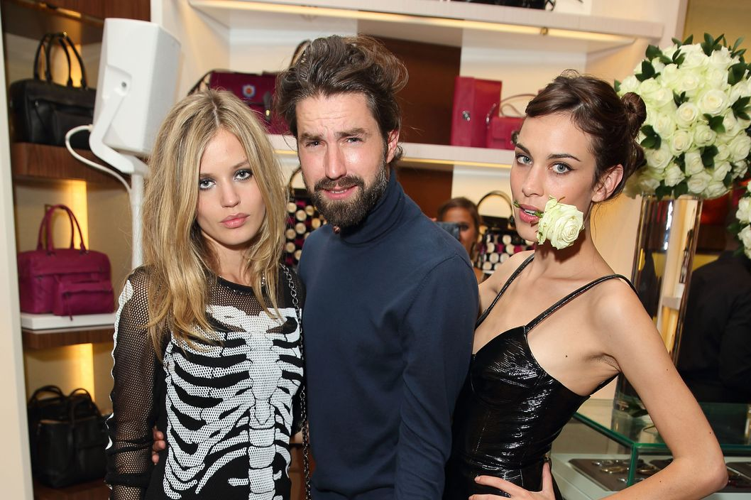 Georgia Jagger, Jack Guinnes and Alexa Chung attend the grand opening party of Longchamp Regent Streetat Longchamp on September 14, 2013 in London, England.