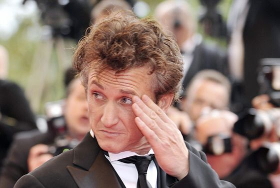 "US actor and director and President of the Jury Sean Penn gestures as he arrives to attend the Closing Ceremony of the 61st Cannes International Film Festival on May 25, 2008 in Cannes, southern France. The May 14-25 festival winds up with the awards ceremony for the prestigious Palme d'Or, to be determined by a jury headed by Hollywood ""bad boy"" Sean Penn.    AFP PHOTO / ANNE-CHRISTINE POUJOULAT (Photo credit should read ANNE-CHRISTINE POUJOULAT/AFP/Getty Images)"