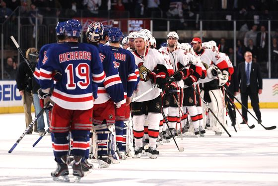 NEW YORK, NY - APRIL 26:  The Ottawa Senators congratulate the New York Rangers after the Rangers defeated the Senators 2 to 1 in Game Seven of the Eastern Conference Quarterfinals during the 2012 NHL Stanley Cup Playoffs at Madison Square Garden on April 26, 2012 in New York City.  (Photo by Bruce Bennett/Getty Images)