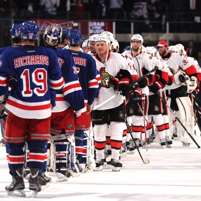 The Ottawa Senators congratulate the New York Rangers after the Rangers defeated the Senators 2 to 1 in Game Seven of the Eastern Conference Quarterfinals