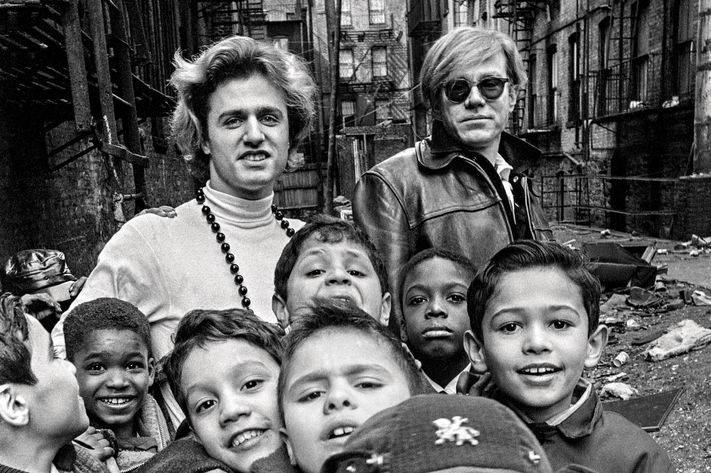 Gerard Malanga and Andy Warhol with Lower East Side schoolchildren.