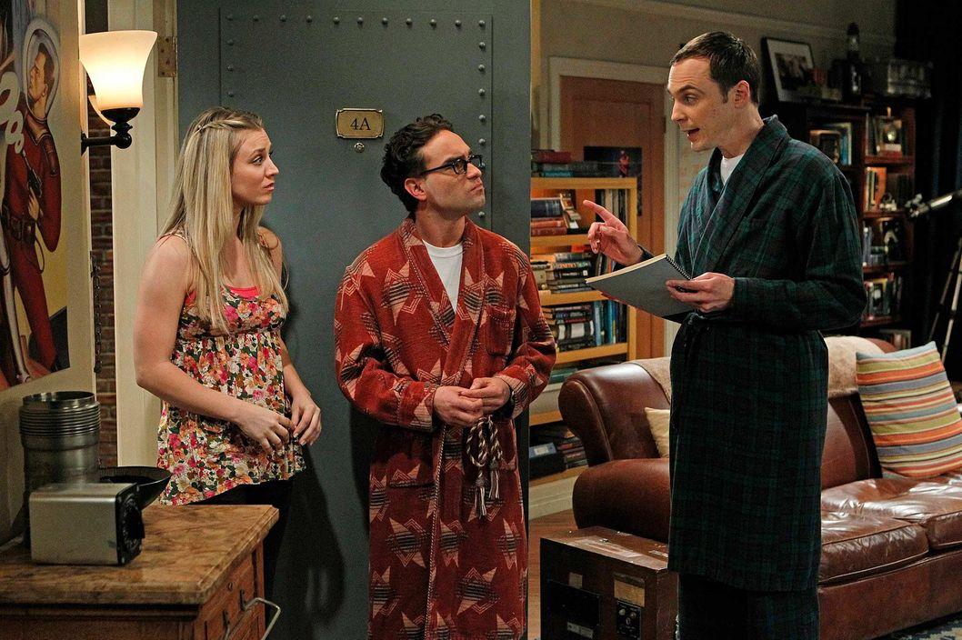 Sheldon (Jim Parsons, right) does not approve when Penny (Kaley Cuoco, left) asks Leonard (Johnny Galecki, center) to lie to her father on THE BIG BANG THEORY.