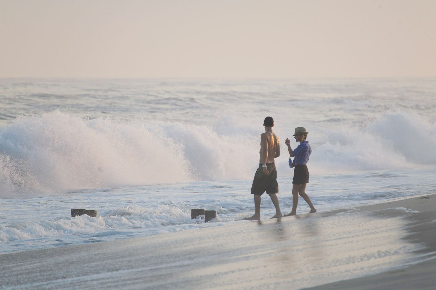 Beachgoers enjoy the huge waves prior to the arrival of Hurricane Irene on August 26, 2011 in Southampton, New York.