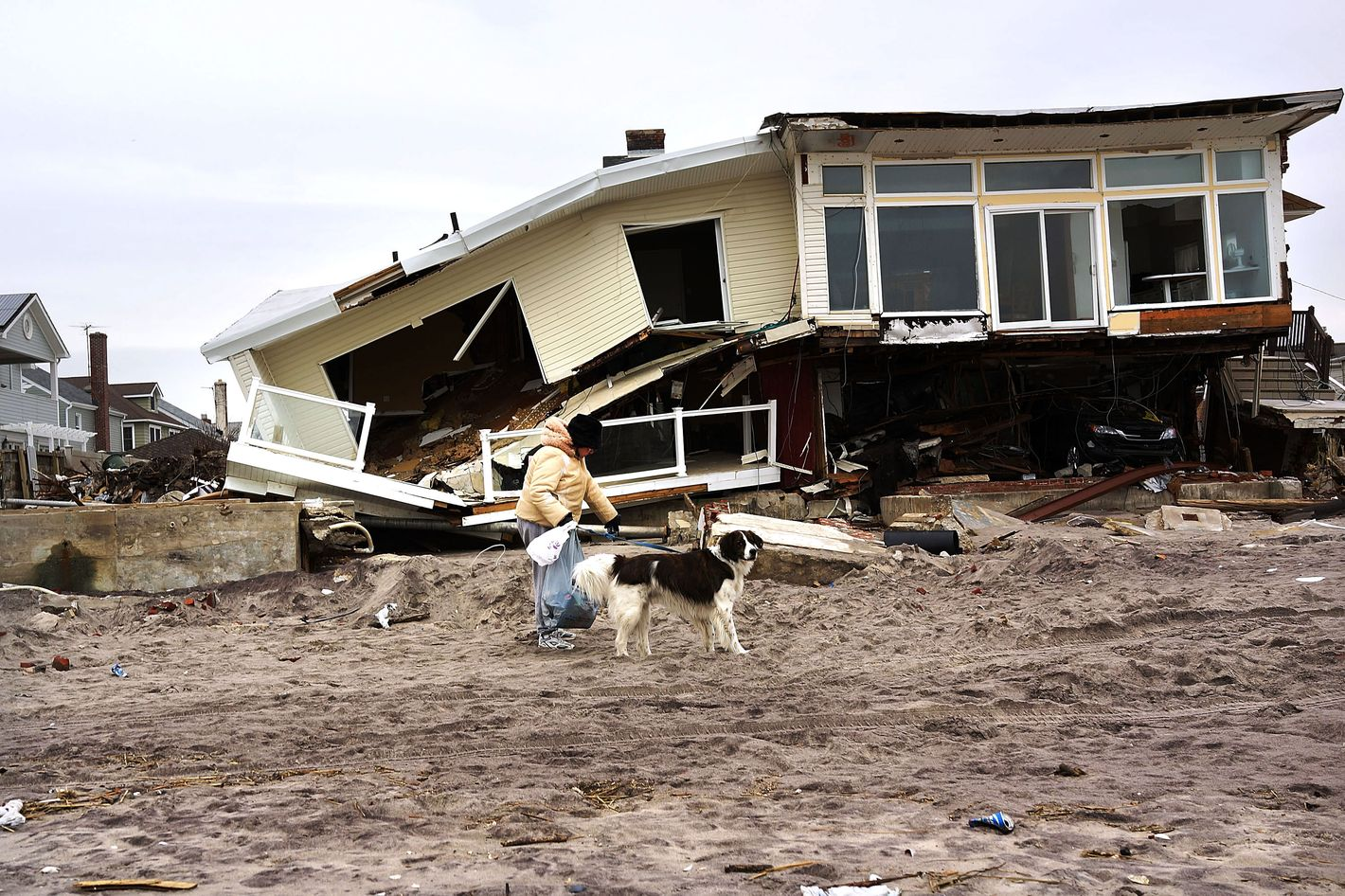 A woman walks with her dog by homes damaged by Hurricane Sandy along the beach in the Rockaways on January 15, 2013 in New York City. A $50.7 billion Superstorm Sandy aid package is expected to be voted on today in the House. The package, which has come under criticism by some fiscal conservatives, is being heavily pushed by Northeastern lawmakers. The money would be spent on immediate needs to the region including $5.4 billion for New York and New Jersey transit systems and $5.4 billion for the Federal Emergency Management Agency's disaster relief aid fund.