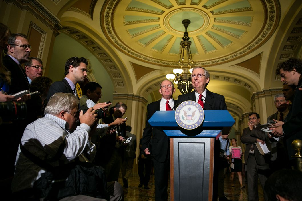 Senate Minority Leader Mitch McConnell (R-KY) (R) and U.S. Sen. Lamar Alexander (R-TN) give a press conference after meeting with fellow Republican Senators on Capitol Hill, July 9, 2013 in Washington, DC. The senators fielded questions about student loan legislation.