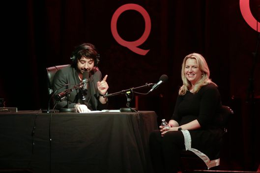 "PORTLAND, OR - APRIL 24: Cheryl Strayed author of the best-selling book, ""Wild,"" is interviwed by Jian Ghomeshi (R) for the radio show Q With Jian Ghomeshi live at Aladdin Theater on April 24, 2014 in Portland, Oregon. (Photo by Natalie Behring/Getty Images)"
