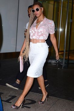 27 May 2014, New York City, New York State, USA --- EXCLUSIVE: Beyonce was spotted out in NYC on Tuesday evening wearing a very stylish summer outfit. She wore a thin pink blouse, with a white lace skirt. She sucked on a Red Lollipop as she left a NYC Office Building. Her long blonde locks were still on full display, as she embraces her new do. Pictured: Beyonce --- Image by ? 247PapsTV/Splash News/Corbis
