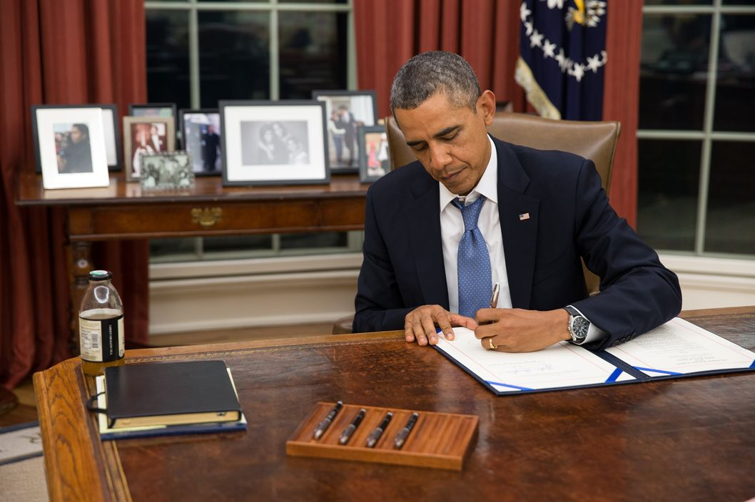President Barack Obama signs H.R. 3210, Pay Our Military Act, which provides continuing appropriations for pay and allowances for members of the Armed Forces during any period for which interim or full-year appropriations for FY 2014 are not in effect, in the Oval Office, Monday night, Sept. 30, 2013.(Official White House Photo by Pete Souza)