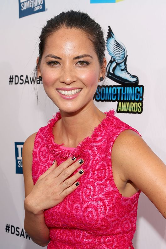 Actress Olivia Munn arrives at the 2012 Do Something Awards at Barker Hangar on August 19, 2012 in Santa Monica, California.