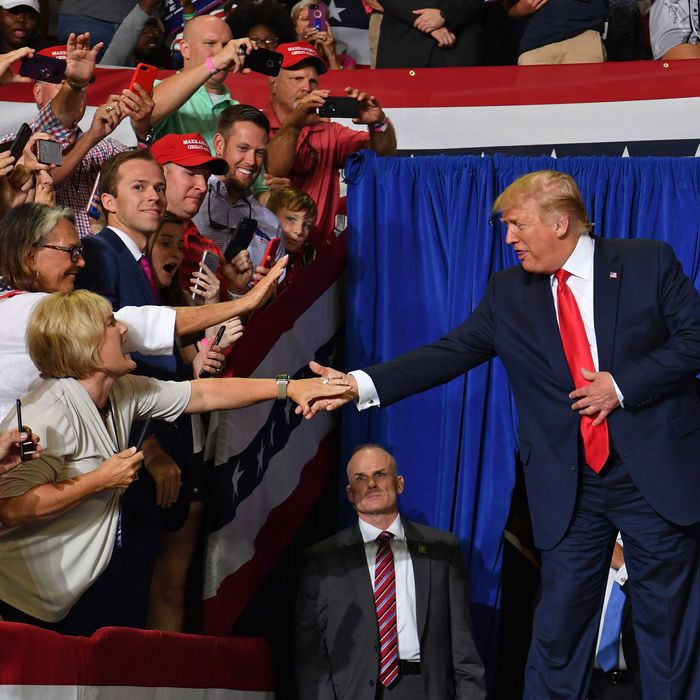 President Donald Trump greets supporters at his rally in Greenville, North Carolina.