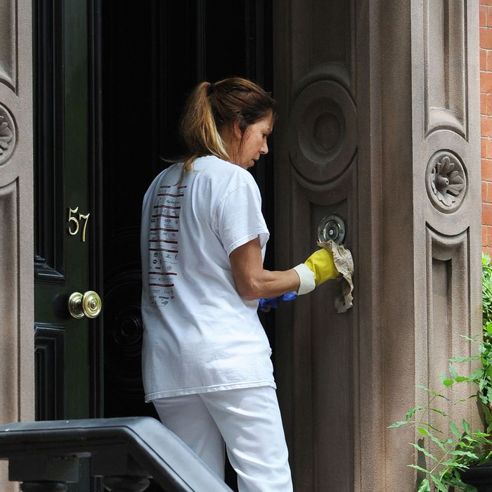 Workers clean Sarah Jessica Parker's West Village residence in preparation for President Obama's June 14 fundraising dinner.