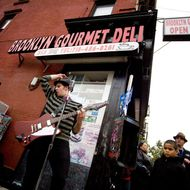NEW YORK - NOVEMBER 1:  The Matty B and the Dirty Pickles rock band play for the runners of the 40th ING New York City Marathon as they pass through the Williamsburg section of the borough of Brooklyn on November 1, 2009 in New York City.  Meb Keflezighi who won New York City Marathon was the first American champion to do so since 1982 in the time 2:09.15. More than 40,000 people participated in the event.  (Photo by Afton Almaraz/Getty Images)